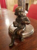 Sujet ancien en bronze patiné représentant un amour époque XIX ème s