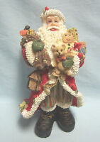 "Santa Figurine loaded with bag of Christmas toys Resin Nice Detail 8 1/2"" Tall"