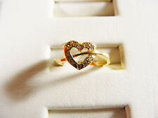 Heart with embedded mini diamonds on a 18k solid Yellow Gold Band