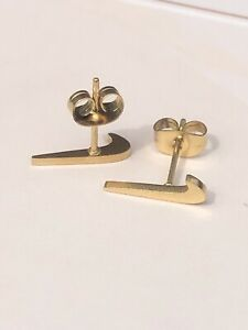 nike stud earrings gold swoosh check tick