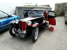 PHOTO  A VERY NICE 1948 MG TC WAS JUST ONE OF A SELECT GATHERING OF CLASSIC CARS