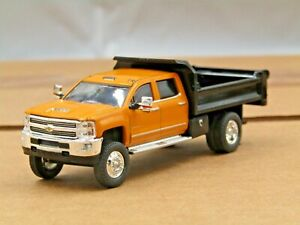 dcp/greenlight dually Custom lifted orange/black Chevrolet 3500 dump truck 1/64.