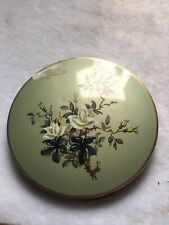 Stratton Compact With Flowers On Green Background