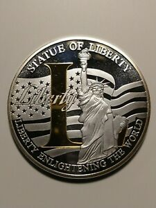 "Liberty L ""Enlightening the world""  Centennial Commemorative Coin"