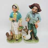 "Vintage Set Bisque Porcelain Figurines Old Man w/Duck & Old Woman w/Chicken 8""h"