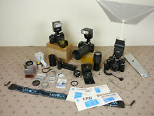 3 Minolta Film SLR Cameras (1 X-700) with 2x Motor Drive 1, TTL flashes, lenses