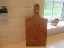 Great old cutting board with handle and hole to hang. Patina wow.