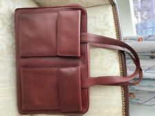 Pineider Ladies Leather bag with two front pockets seldom used.Maroon color