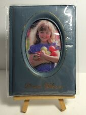 """4.25"""" x 5.5"""" inch Photo Album and wooden stand."""