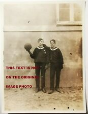 Old photo: Two teen boys in sailor uniform with football in school yard Fo.008