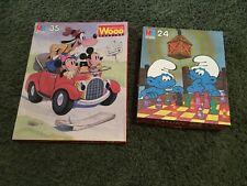 Lot of 2 vintage puzzles by MB Puzzle, Smurf 24 pc, Walt Disney 35 pc (1982)