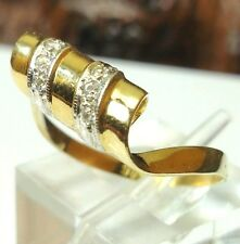 Handcrafted Solid 14 karat yellow gold and diamond twisted ribbon ring