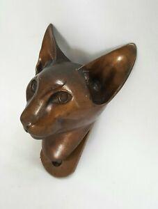 Unusual vintage bronze door knocker modelled in the form of a Siamese cat head.