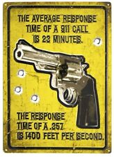 RESPONSE TIME OF A 911 CALL IS 23 MINUTES OF A 357 IS A SECOND EMBOSSED TIN SIGN