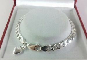 Sterling Silver Ladies Curb Bracelet & Heart Charm. 7.5 inch. 8.4g.