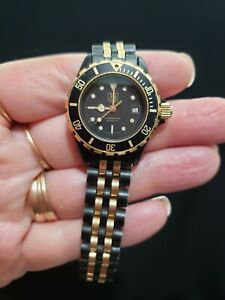 "TAG Heuer Professional Ladie's Watch Model 980.028B Black & Gold 7"" Band"