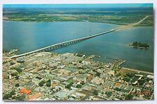 Postcard AIR VIEW OF FT. MYERS SHOWING NEW BRIDGE & CALOOSAHATCHEE RIVER FLORIDA