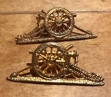 A facing pair of current issue British Army Royal Artillery collar badges.     S