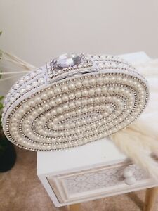 A beautiful clutch bag/purse made of pearls and diamonds.