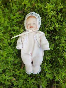 Tiny Vintage Porcelain Baby Doll Pink Babygro Smiling Face Yolanda bell Design