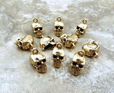 Ten (10) Gold Tone Pewter Skull Charms - 5243