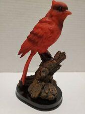Cardinal figurine perched