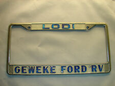 Lodi GEWEKE FORD RV Dealership Metal License Plate Frame HOLDER Embossed Old