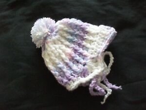 HANDCROCHETED CHUNKY HELMET TYPE BOBBLE HAT WITH CHIN STRAPS--TO FIT 0-3 MONTHS.
