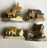 Lot of 4 Collectible Figurines David Winter Cottage, British Traditions and more