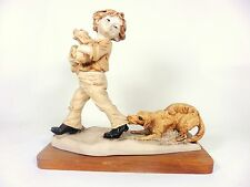 Labrador Retriever and Boy with Puppies Figurine