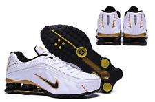 brand new 40ba2 e0477 Nike Shox R4 men white ,black ,gold size 10 UK  45 EUR