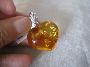 Cognac Amber heart pendant, 27mm x 24mm, in 2.26 grams of 925 Sterling Silver