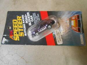 NOS VINTAGE AFX SPEED STEER #21 PURPLE FORD ESCORT SLOT CAR IN PACKAGE #6291