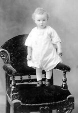 Doubtful looking infant on chair - Isaac Erb & Son, Saint John, NB