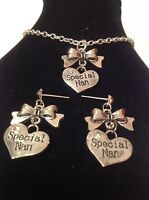 special nan bow necklace and matching stud earrings  silver plated.