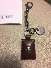 Alexander McQueen leather skull tag key ring in brown for Men-NEW