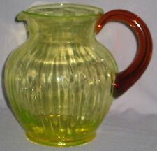 VINTAGE VASELINE VERTICAL RIBBED BULBOUS WATER PITCHER GLOWS w/AMBER HANDLE