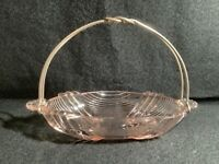 Vintage  Pink glass small oval basket with metal handle.