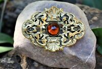 Antique Brass Sash Pin With A Floral Filigree Design And Amber Topaz Stone