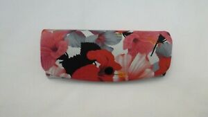 LOTS OF PINK AND RED FLOWERS  COVER THIS NEW GLASSES CASE
