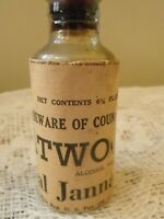 Jannaice Atwoods Glass Bitters Bottle w Cork & Original Wrapping & Label Antique