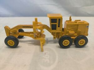 ERTL CATERPILLAR ROAD GRADER MIGHTY MOVERS CONSTRUCTION TOY, nice. Eco shipping.