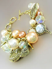 Gold Toned Charm Bracelet With Peach Pearls and Gold Purse, Shoe, Mirror Charms