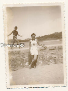 Vintage photo 1930-40s - pretty woman in Summer dress and boy on seaside