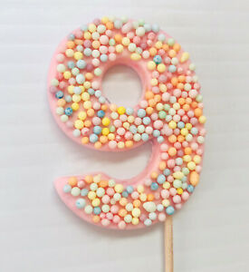 Two Edible Numbers Cake Topper With Sprinkles.