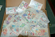BOX OF GLASSINES - FULL WITH WORLD STAMPS MINT & USED ALL ERAS- UNCHECKED