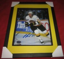 Pavel Bure action Vancouver Canucks Signed and Framed 8x10 Sport Authentix .