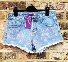 Ladies Summer Denim Shorts with cool floral embroidery and fringe trim.