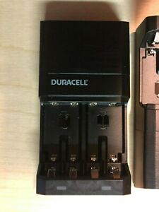 2 left - one DURACELL 4 BATTERIES charger MODEL: CEF27NA3 new