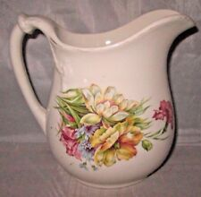 Ironstone Warranted Pitcher with Floral Transfer Prancing Lions Mark